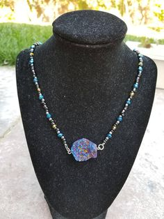 Check out this item in my Etsy shop https://www.etsy.com/listing/547943571/peacock-ore-necklace