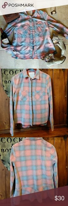 Free people we the free button down shirt Distressed plaid with frayed detail at the bottom and a peplum style to the back. Excellent used condition! Free People Tops Button Down Shirts