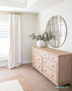 Master bedroom dresser with silver round mirror and greenery in a large white vase. Furniture, Home, Home Bedroom, White Vase Decor, Living Room Sets Furniture, Dresser Decor Bedroom, Bedroom Inspirations, Large Master Bedroom Ideas, Dresser As Nightstand