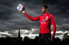 Crystal Palace footballer Wilfried Zaha. Picture by Tom Jenkins for The Guardian. I like the contrast of light and dark and the way the church steeple points to the ball.
