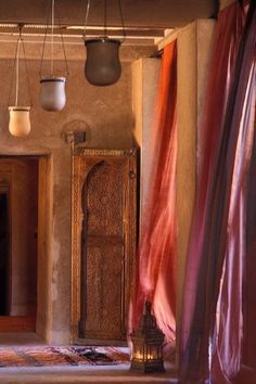 I like the idea of different colored sheer curtains as a shower curtain