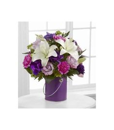 Celebrate Easter with the Color Your Day With Beauty Purple FTD from Brant Florist online worldwide florist. Same day delivery to USA and Canada Online Florist, Asiatic Lilies, Incredible Gifts, Easter Flowers, Lavender Roses, Lush Green, Paint Cans, Carnations, Bold Colors