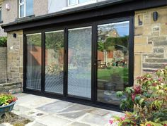 Smart Visofold 1000 bi fold doors with integral blinds to the sealed units. Recently supplied to local construction company M A Builders for a house extension in Shipley, West Yorkshire .