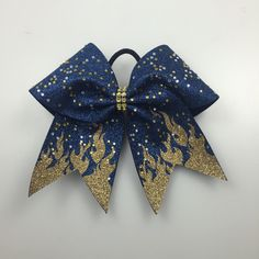 A personal favorite from my Etsy shop https://www.etsy.com/listing/264960000/flame-cheer-bow-custom-navy-and-gold