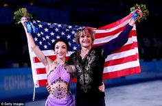 All smiles: Meryl Davis and Charlie White celebrate winning the first ever the figure skating ice dance gold for the United States at the Sochi Winter Olympics