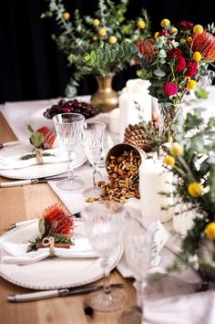 Christmas table setting featuring Australian native plants (wattle, eucalyptus leaves and bottle brush) as well as crystal glassware   Photo: The Home   Styling: George & Smee