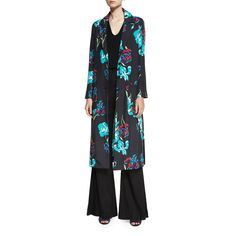 --evaChic--This Diane von Furstenberg Collared Floral Print Silk Coat is a statement layering piece featuring the brand's custom Ainsworth print in a relaxed fit, midi-length silhouette. The stunning transitional weather outerwear piece is accented with oversize front pockets and exaggerated side seam slits for a feminine avant-garde look.        https://www.evachic.com/product/diane-von-furstenberg-collared-floral-print-silk-coat/