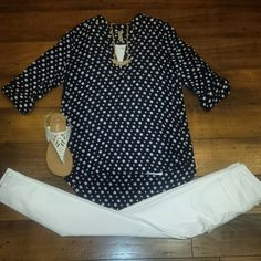 Super cute navy and white polka dot top! We absolutely LOVE it paired with white denim and statement jewelry!