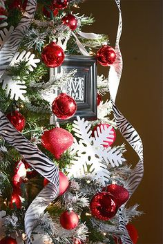 "Nice site with tips on how to professionally decorate your Christmas tree, as well as how to ""flock"" an artificial tree."