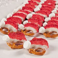 Santa Hat Pretzels -  Dip in melted marshmallows ir white chocolate - add sprinkles and a mini marshmallow
