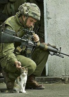 Soldier and cat..!!! Bebe'!!! The gentleness of a soldier!!!