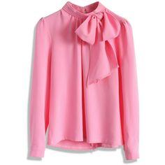 Blusa manga longa com decote laço cor rosa.