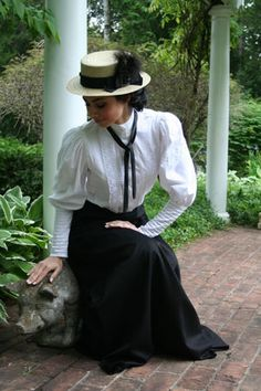 I treasure vintage day wear. This specific outfit features a floor-length fan twill skirt, a Victorian blouse, a neck tie, and a straw skimmer hat.