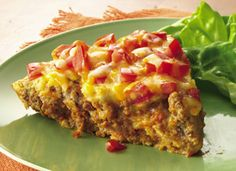 1  pound lean ground beef  1  medium onion, chopped (1/2 cup)  1  package (1 ounce) Old El Paso® taco seasoning mix  1  can (4.5 ounces) Old El Paso® chopped green chiles, drained  1  cup milk  2  eggs  1/2  cup Original Bisquick® mix  3/4  cup shredded Monterey Jack or Cheddar cheese (3 ounces)  Old El Paso® salsa (any variety)  Sour cream, if desired