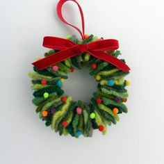 15 Stunning Repurposed WreathsWhat do marshmallows, garden hose, old sweaters, and bicycle wheels have in common? They can all be made into gorgeous wreaths! Wreaths are so festive.