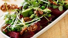 Beetroot and avocado salad with miso dressing and walnut brittle.