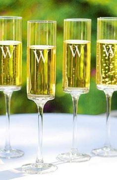 Love! Monogrammed champagne flutes to toast the newly married couple.