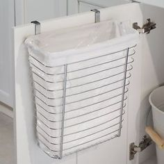 ******Hang shoe organizer over upstairs bathroom door to hold toiletries. Use the upper space and hang a towel rack below?