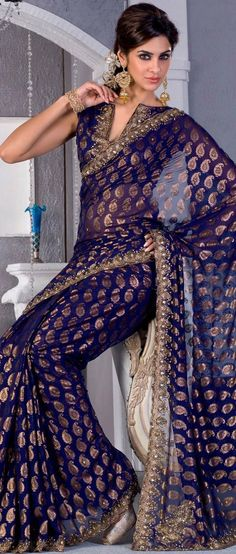 Deep blue georgette saree fabulously designed with Sea Border, golden print, zari and cutdana work. Deep blue georgette saree fabulously designed with Sea Border, golden print, zari and cutdana work. India Fashion, Asian Fashion, Gold Fashion, Indian Dresses, Indian Outfits, Indian Clothes, Beautiful Saree, Beautiful Dresses, Gorgeous Eyes