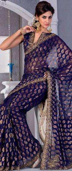 Deep blue georgette saree fabulously designed with Sea Border, golden print, zari and cutdana work. Deep blue georgette saree fabulously designed with Sea Border, golden print, zari and cutdana work. Georgette Sarees, Lehenga Choli, India Fashion, Asian Fashion, Gold Fashion, Indian Dresses, Indian Outfits, Indian Clothes, Moda India
