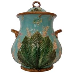 Large George Jones Lidded Majolica Jar - George Jones Majolica large covered jar with horse chestnut leaves and blooms, naturalistic plinth base and handles and trim.- 1870's