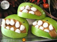 Party Frosting: Halloween~Peanut butter, apple slices, mini marshmallows for teeth. Accent with baby plastic spiders.
