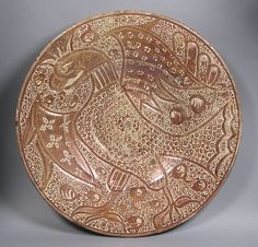 Dish Date: late 15th–early 16th century Geography: Made in probably Manises, Valencia, Spain Culture: Spanish Medium: Tin-glazed earthenware Dimensions: Overall: 18 1/8 in. (46 cm)