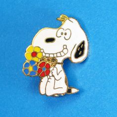 Give us a Smile! Show your love on any outfit with a Snoopy pin! Find them in our shop at CollectPeanuts.com.