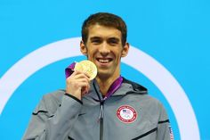 Gold medalist Michael Phelps of the United States poses on the podium during the medal ceremony for the Men's 100m Butterfly Final on Day 7 of the London 2012 Olympic Games at the Aquatics Centre on August 3, 2012 in London, England.