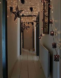 Contemporary Christmas decorations in a scandi home with lots of fairy lights and paper stars Christmas Hallway, Noel Christmas, All Things Christmas, Winter Christmas, Christmas Crafts, Hygge Christmas, Rustic Christmas, Christmas Decorations For The Home Living Rooms, Christmas Wreaths