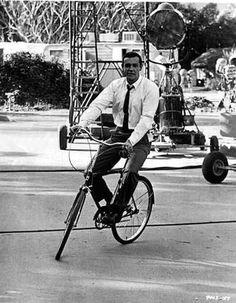 Sean Connery riding a bike