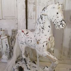 Large white rocking horse vintage French Nordic wooden hand painted white distressed rusty wheels shabby chic wood sculpture Anita Spero