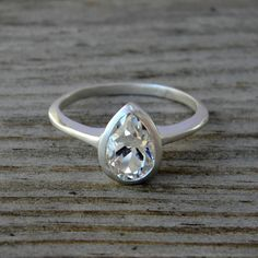 White Topaz Gemstone Ring, Pear Shaped Ring in Sterling Silver, Made To Order. $138.00, via Etsy.