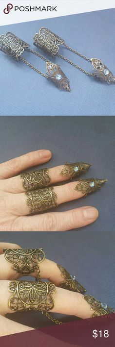 Pair of Elven Finger rings Antique brass filigree rings with chain attachments.   Two blue swavorski crystals on tips. Filigree rings are bendable for a perfect fit.  NWOT. Jewelry Rings