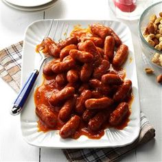 Party Franks Recipe -These tiny, tangy appetizers have such broad appeal. I prepare them often for holiday gatherings, weddings and family reunions. They're convenient to serve at parties since the sauce can be made ahead, then just reheated with the franks before serving. —Lucille Howell, Portland, Oregon