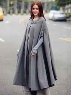 maxi wool cape in winter. fully lined. soft and beautiful. a zipper button on the fastening flattering dress bottom strong sense of presence This design belon Maxi Wool Cape in Grey Gray Cashmere Cloak coat Bing Swing Women S Fashion Dresses Wholesale wiz Wool Cape, Wool Poncho, Cape Coat, Cashmere Poncho, Cape Jacket, Look Fashion, Hijab Fashion, Fashion Dresses, Fashion Goth