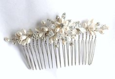 This bridal hair comb made with natural white freshwater pearl and silver rhinestone ornament.    It is about 4 Wide and 1 High (with out comb)