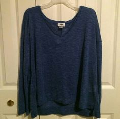 "Sapphire Isle Sweater Knit V-neck Soft, lightweight sweater knit in pretty blue color ""sapphire isle"". Relaxed fit, hits below waist. V neckline, drop shoulders into long sleeve. Drop tail hem with side vents. 80% poly, 20% rayon. Old Navy Tops"