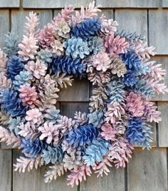 How to Make a Wreath from Pinecones. See the video and tutorial to make a gorgeous wreath by using spray painted pinecones with your favorite colors. #wreath #DIY #tutorial