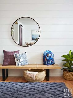 modern entryway with bench and mirror
