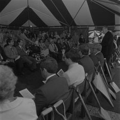 Black and white photograph of the ground breaking ceremony for the University of Scranton Weinberg Memorial Library, held on July 12, 1990. University President J. A. Panuska, S. J., is at the podium.
