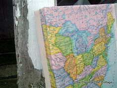 Cover a canvas with a map -- for our travels after hubby retires!