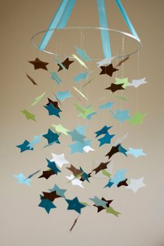 DIY mobile ideas- when I first saw this I thought it was painted puzzle pieces. Now I kind of like that idea!