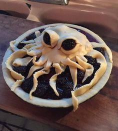 Amazing cthulhu pie. Rising out of the depths of blackberries no less.