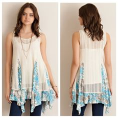 Asymmetrical Handkerchief Lace Tunic Natural Solid lace ruffled top featuring printed contrast detailing. Handkerchief ruffle hem. Sheer. Unlined. Knit. Light weight. 65% Polyester, 35% Rayon  1/2/1 TE2701C627  No trades! Tops