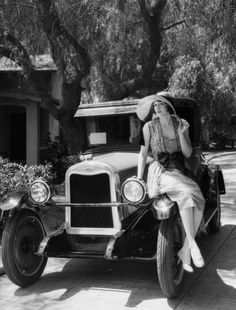 Betty Boyd posing on a 1926 Chevrolet, photo by Dick Wittington.