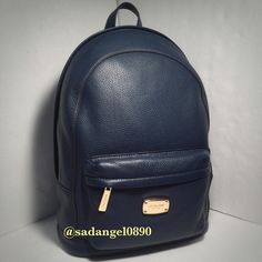 ❥❥NEW MICHAEL KORS LARGE JET SET NAVY BACKPACK❥❥ ❥❥Zip closure MK signature logo patterned PVC with leather trim and /gold tone hardware Lined interior with zippered pocket and 5 open slip pockets Fully zippered top closure; exterior zippered pocket Dual adjustable shoulder straps and top tab Measures approximately 11.5 inches (L) x 15 inches (H) x 5 inches (W) Came from a smoke-free and pet-free environment Michael Kors Bags Backpacks