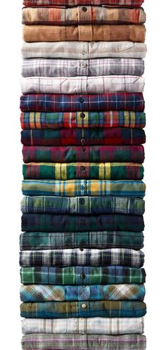 Stack of flannel shirts.