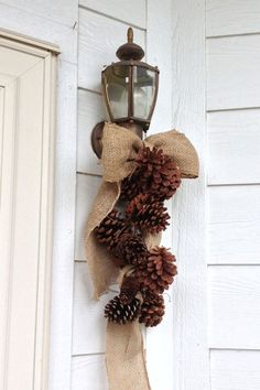 Love! Burlap ribbon and pinecones wired together! hang inside using cinnamon scented pinecones!