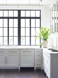 marble counter tops + painted cabinets. great window!